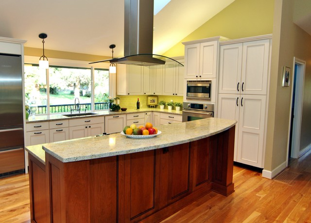 Custom white cabinetry with a glaze finish was contrasted dark island traditional-kitchen