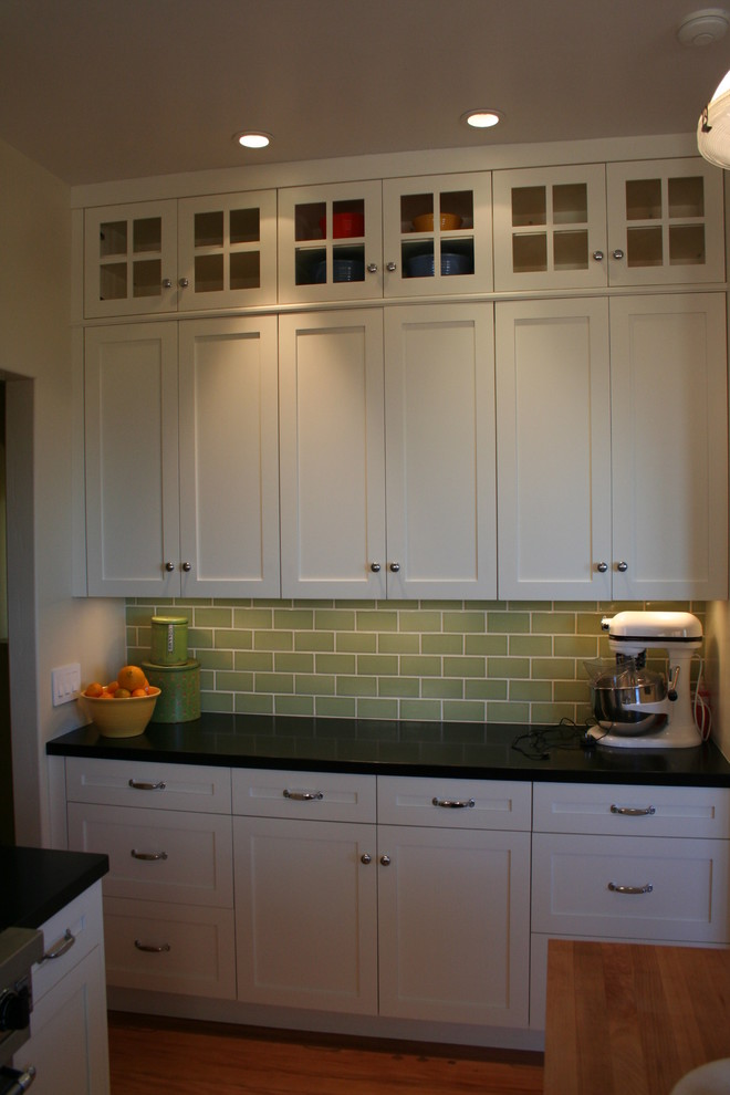 Kitchen Cabinets With Glass Doors On Top Glass doors on top lighten the bank of cabinets without showing