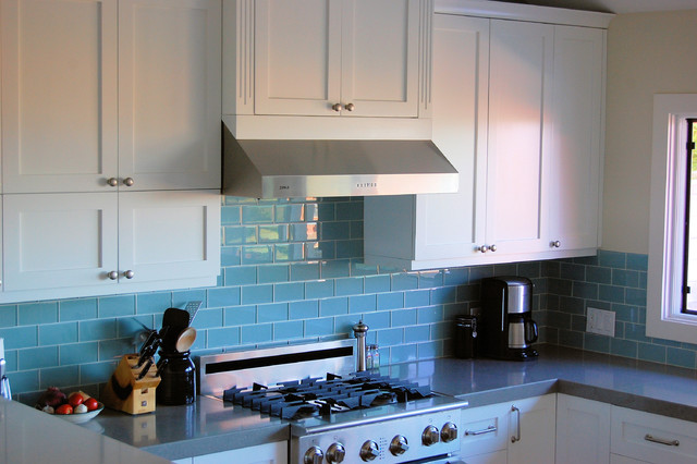 Beau Example Of A Trendy Kitchen Design In Other With White Cabinets, Blue  Backsplash, Glass
