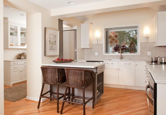 Elegant l-shaped kitchen photo in DC Metro with recessed-panel cabinets, glass tile backsplash, beige backsplash and white cabinets