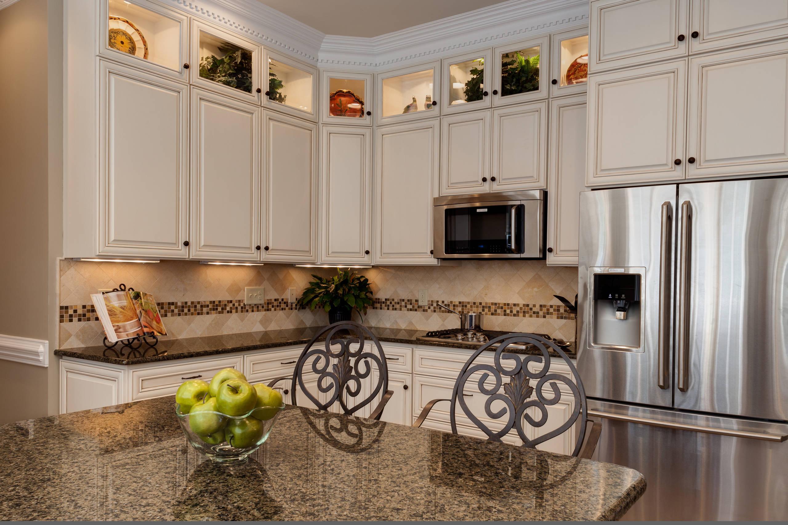 Tropical Brown Granite White Cabinets