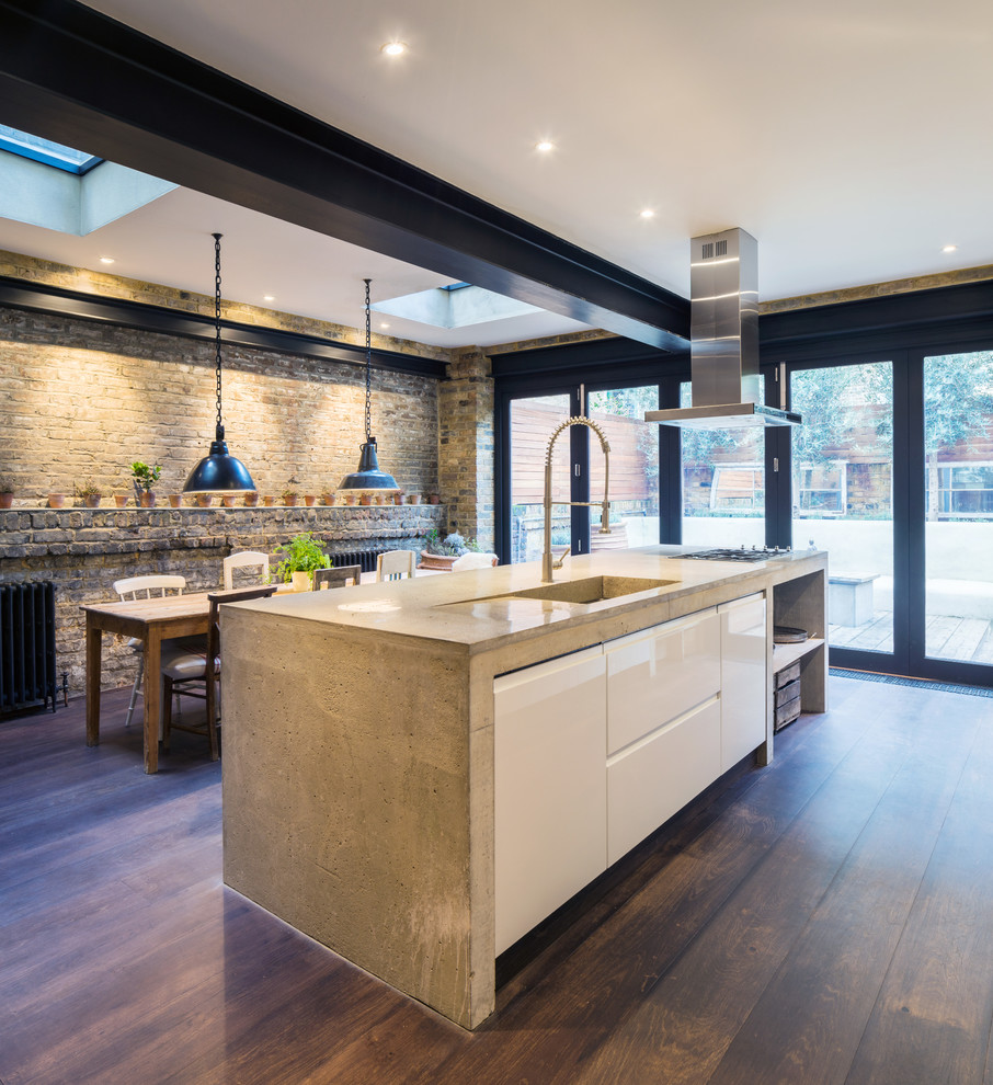 Inspiration for a contemporary dark wood floor eat-in kitchen remodel in London with flat-panel cabinets and white cabinets