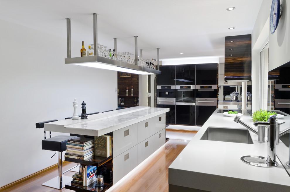Kitchen - contemporary kitchen idea in Brisbane with stainless steel appliances