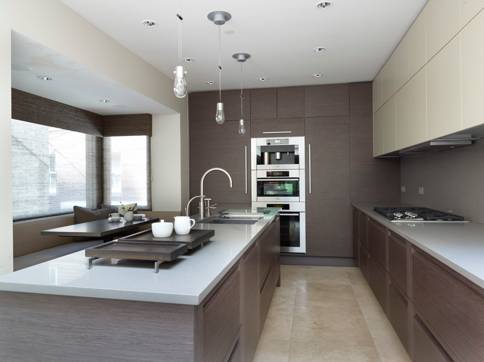 Trendy eat-in kitchen photo in Chicago with paneled appliances, flat-panel cabinets and gray cabinets