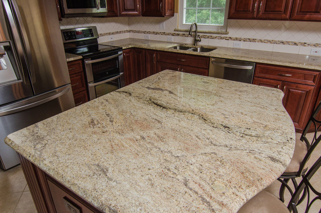 Golden Ivory Granite With Cherry Cabinets Traditional
