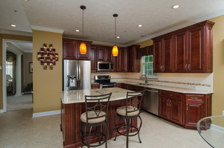 cherry and white kitchen cabinets golden ivory granite with cherry cabinets 13482