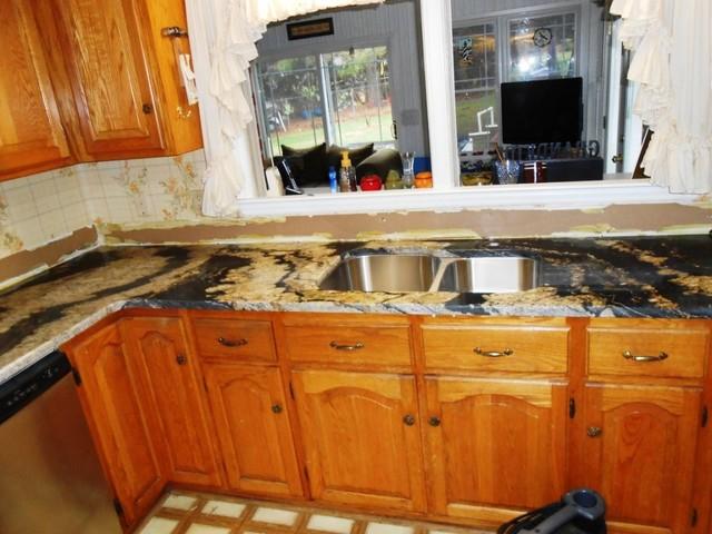 GOLDEN SUPREME Granite on Medium colored Cabinets traditional-kitchen