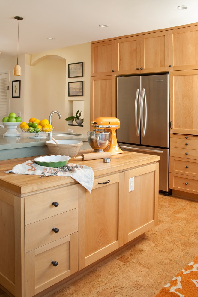 Large elegant l-shaped eat-in kitchen photo in Santa Barbara with stainless steel appliances, light wood cabinets and an island