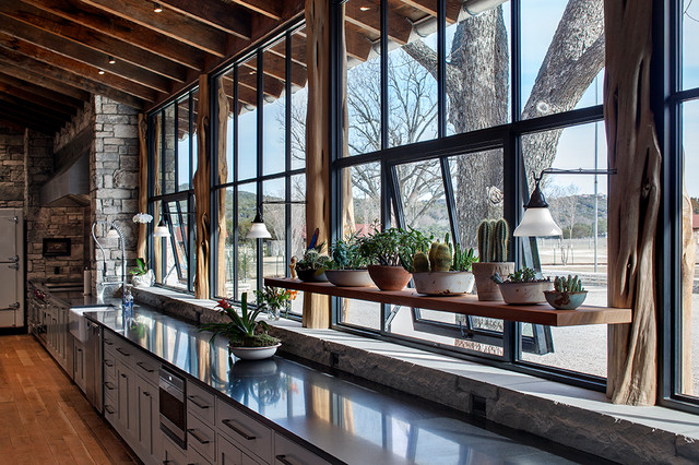 Grand lodge rustic kitchen austin by rehme steel for Operable awning windows