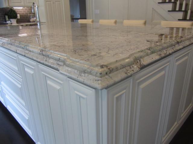 Granite And Engineered Quartz Countertops Traditional Kitchen