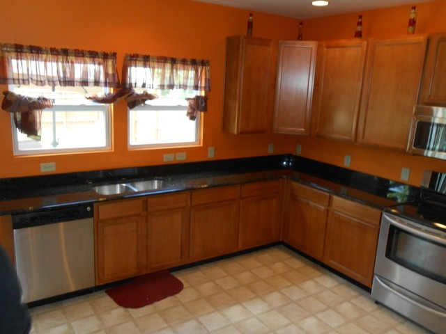 Granite colors that work well with medium colored cabinets for Charlotte kitchen cabinets