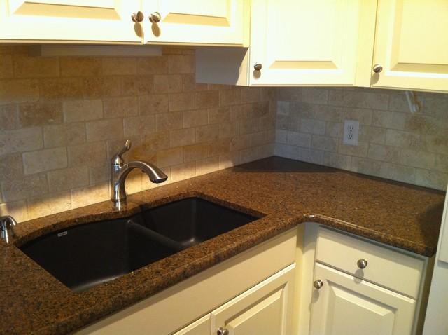 granite countertop and natural stone backsplash