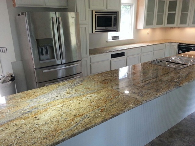 Granite Countertops And Marble Fireplace Traditional Kitchen