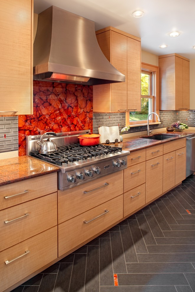 Large trendy galley porcelain tile eat-in kitchen photo in Portland with granite countertops, an undermount sink, flat-panel cabinets, gray backsplash, glass tile backsplash, stainless steel appliances and light wood cabinets