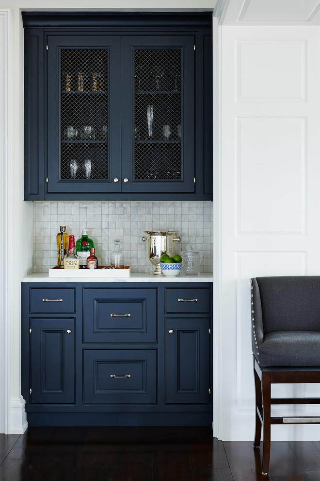Kitchen - beach style kitchen idea in Jacksonville with blue cabinets, mosaic tile backsplash and gray backsplash