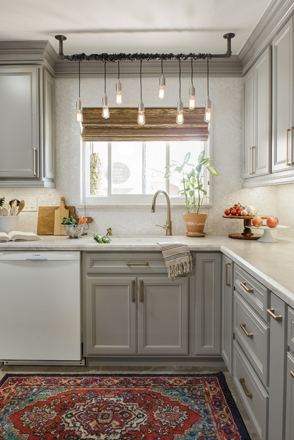 Gray Cabinets Brighten This Small Light & White ...