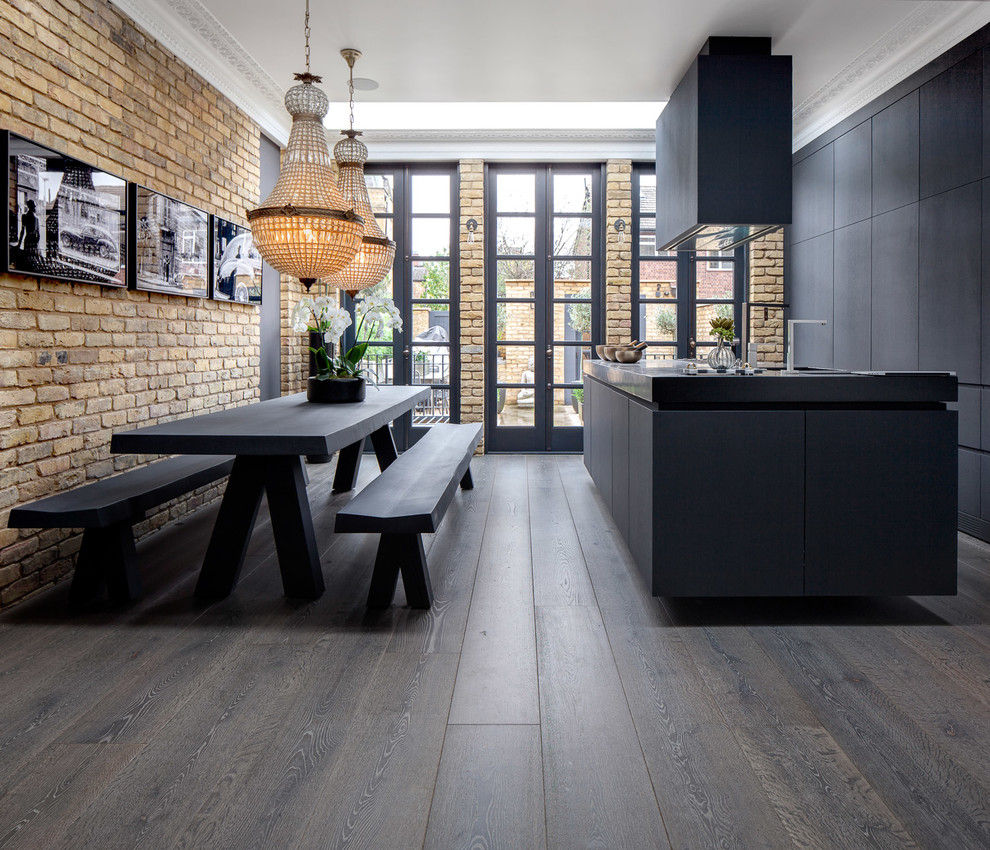 Inspiration for a mid-sized eclectic single-wall dark wood floor and brown floor eat-in kitchen remodel in Other with flat-panel cabinets, black cabinets, an island and paneled appliances