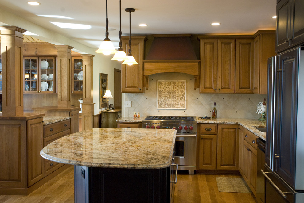 Inspiration for a timeless kitchen remodel in Minneapolis with stainless steel appliances, granite countertops and travertine backsplash