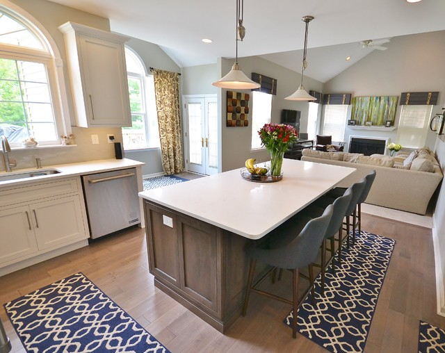 Eat-in kitchen - large transitional l-shaped medium tone wood floor and beige floor eat-in kitchen idea in Philadelphia with an undermount sink, recessed-panel cabinets, white cabinets, quartz countertops, gray backsplash, ceramic backsplash, stainless steel appliances and an island
