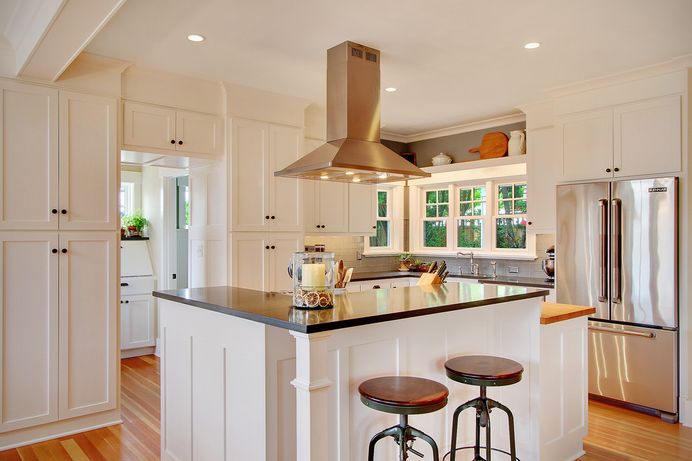 Kitchen - traditional kitchen idea in Seattle with shaker cabinets, stainless steel appliances and white cabinets