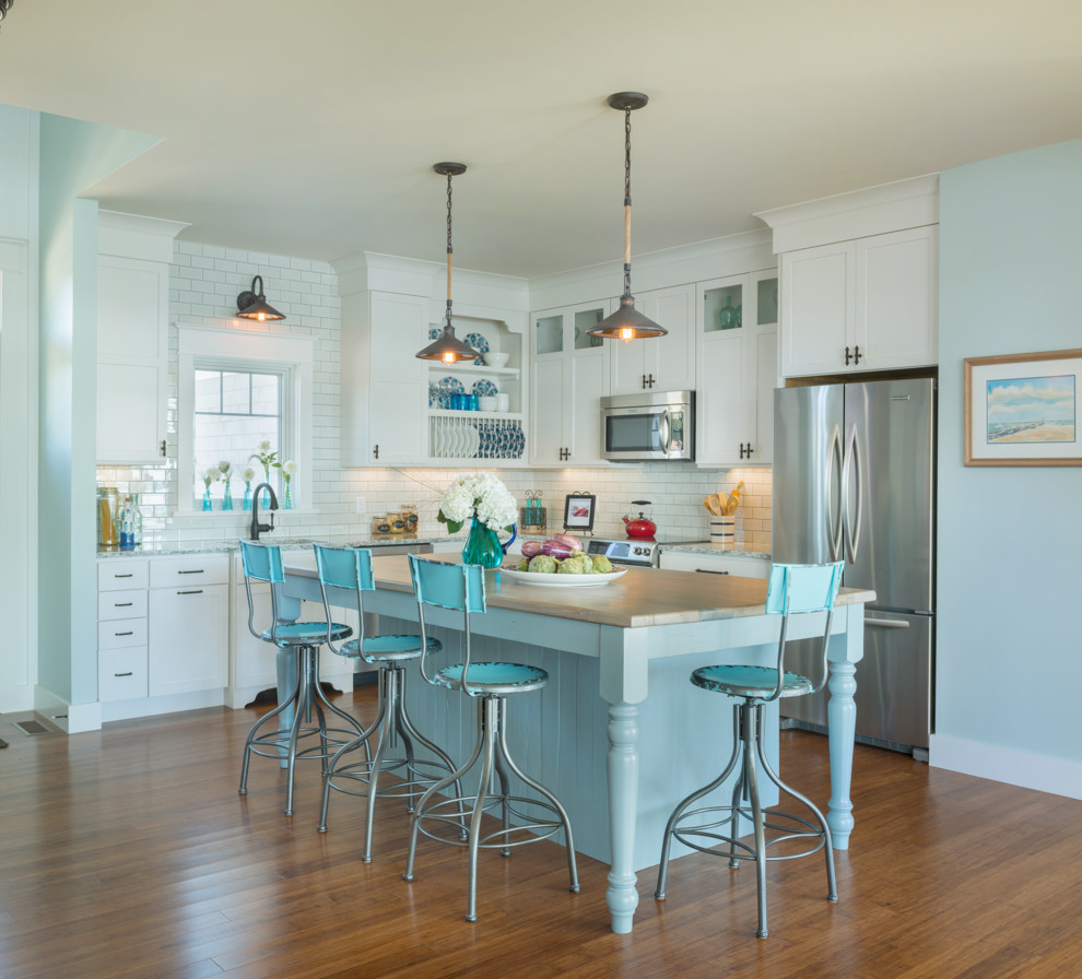 Beach style l-shaped open concept kitchen photo in Providence with shaker cabinets, white cabinets, quartz countertops, white backsplash, stainless steel appliances and subway tile backsplash