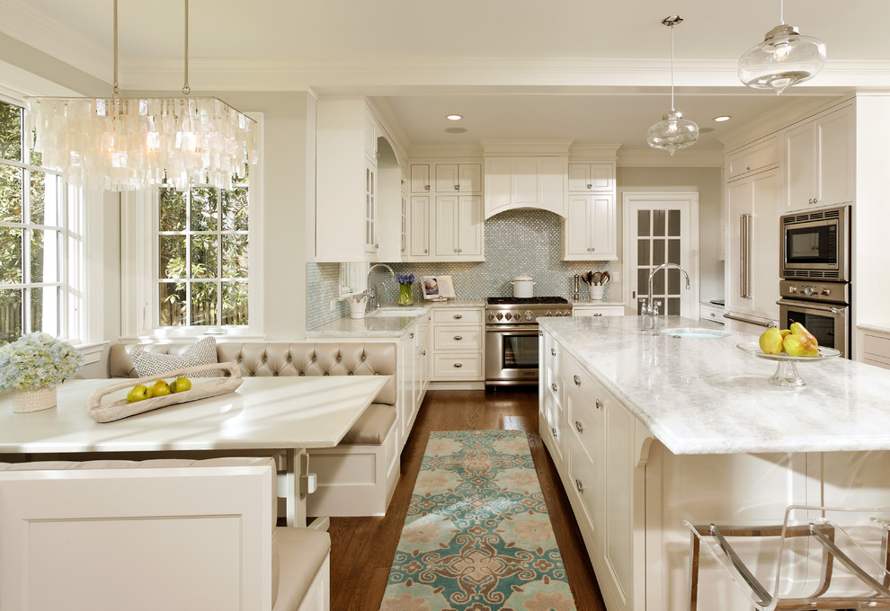 Elegant l-shaped eat-in kitchen photo in DC Metro with stainless steel appliances, recessed-panel cabinets, white cabinets, quartzite countertops, blue backsplash and glass tile backsplash