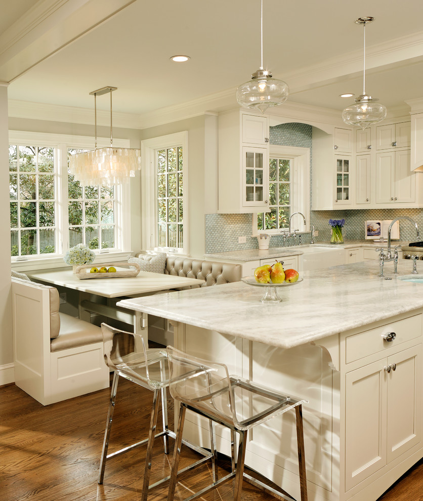 Elegant kitchen photo in DC Metro with mosaic tile backsplash, quartzite countertops, a farmhouse sink, recessed-panel cabinets, white cabinets, blue backsplash and white countertops