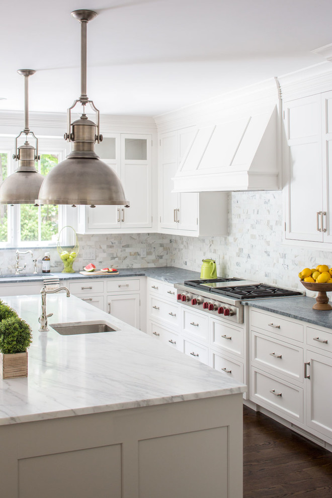 Example of a large trendy l-shaped dark wood floor open concept kitchen design in New York with an undermount sink, shaker cabinets, white cabinets, soapstone countertops, white backsplash, stone tile backsplash, stainless steel appliances and an island