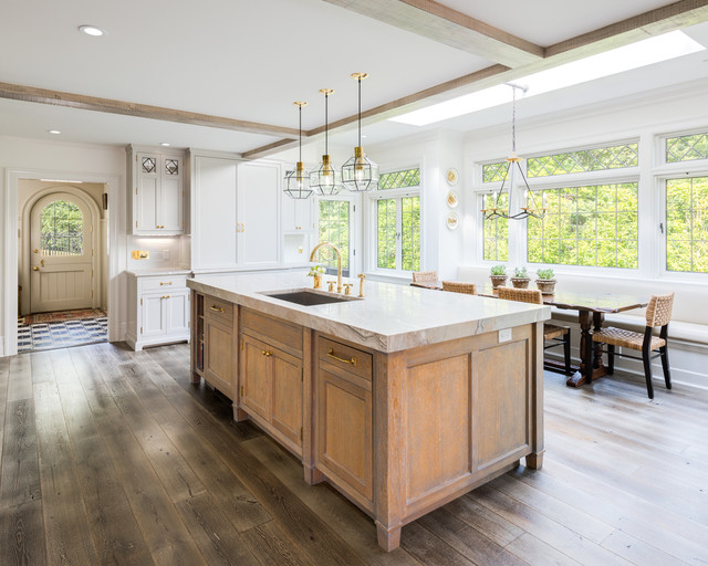 Farmhouse dark wood floor eat-in kitchen photo in New York with an undermount sink, shaker cabinets, medium tone wood cabinets, white backsplash and an island