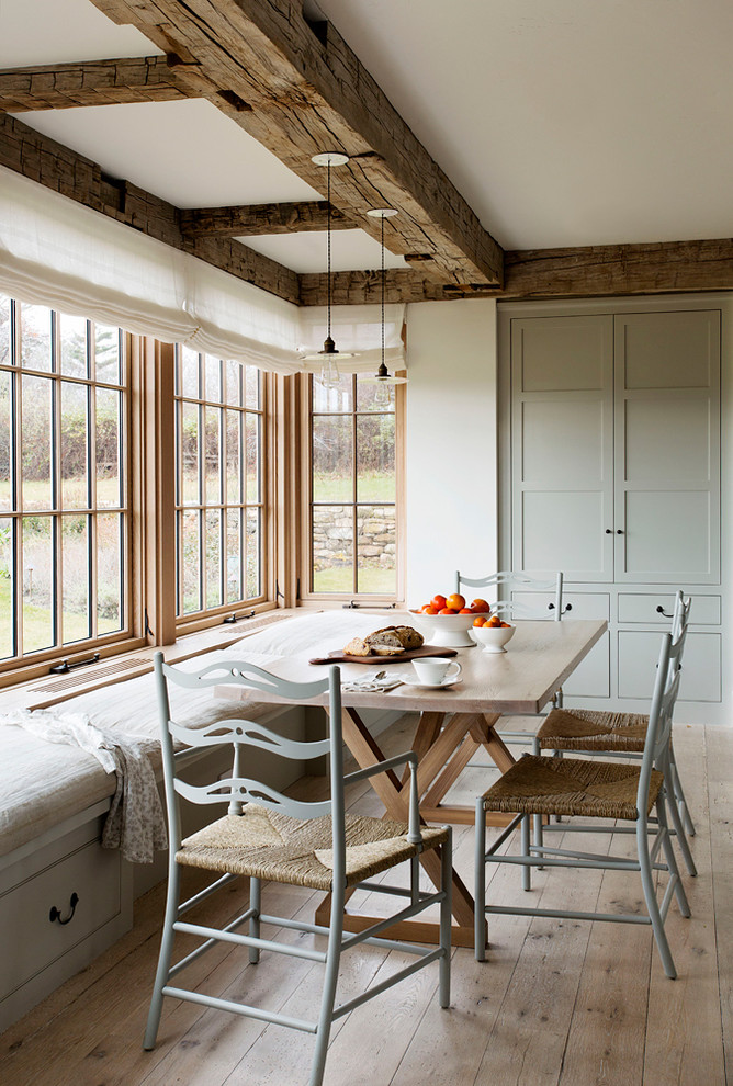 Inspiration for a mid-sized cottage light wood floor eat-in kitchen remodel in Denver with blue cabinets