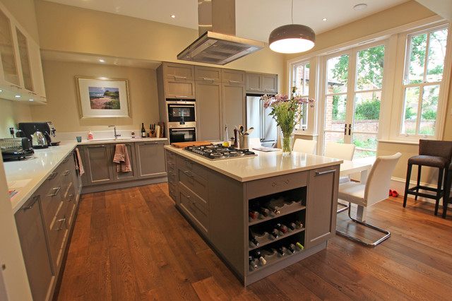 Example Of A Country Medium Tone Wood Floor Kitchen Design In London With Gray Cabinets