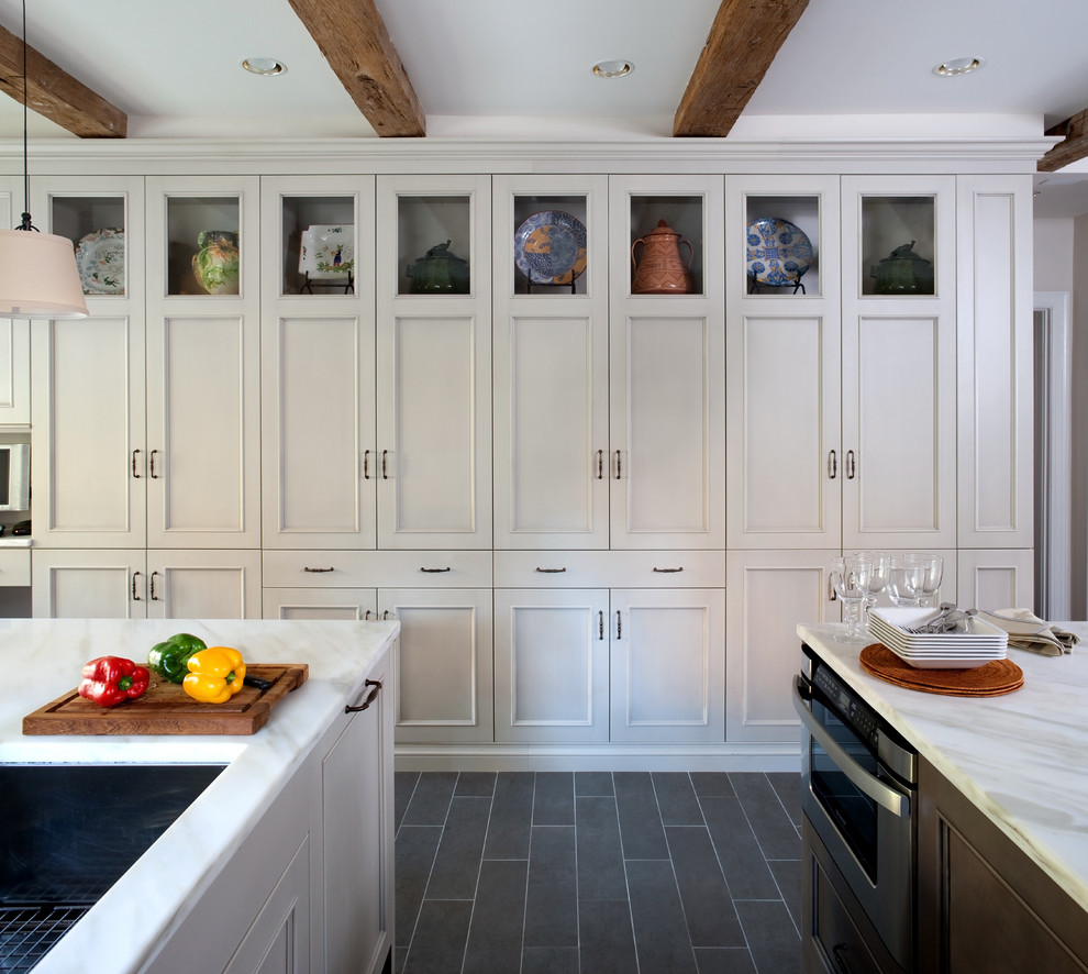 Example of a classic kitchen design in DC Metro with marble countertops
