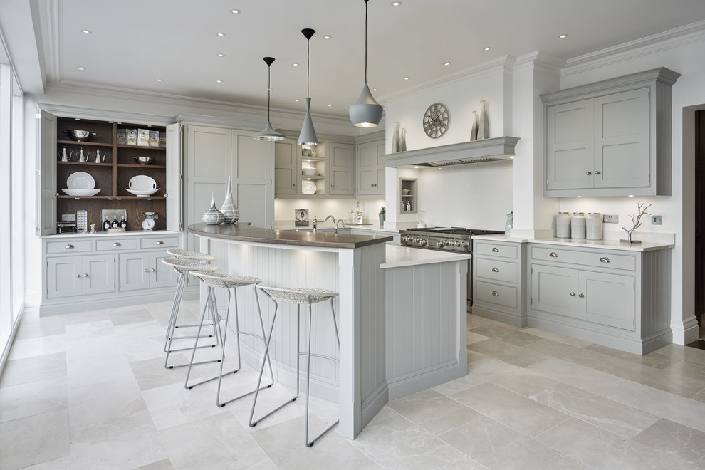 Large elegant u-shaped marble floor and beige floor eat-in kitchen photo in Kent with a farmhouse sink, shaker cabinets, gray cabinets, quartzite countertops, white backsplash, stainless steel appliances and an island