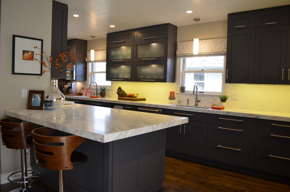 Inspiration for a large contemporary dark wood floor kitchen remodel in Sacramento with an undermount sink, shaker cabinets, gray cabinets, marble countertops, white backsplash, stainless steel appliances and no island