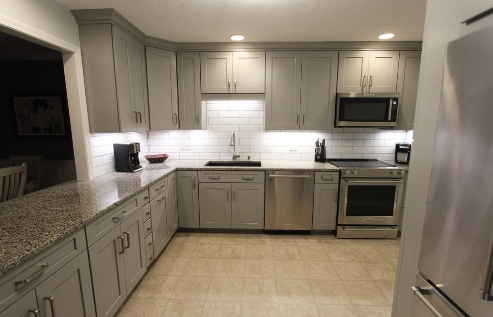 Grey Kitchen With White Subway Tile Backsplash And Granite