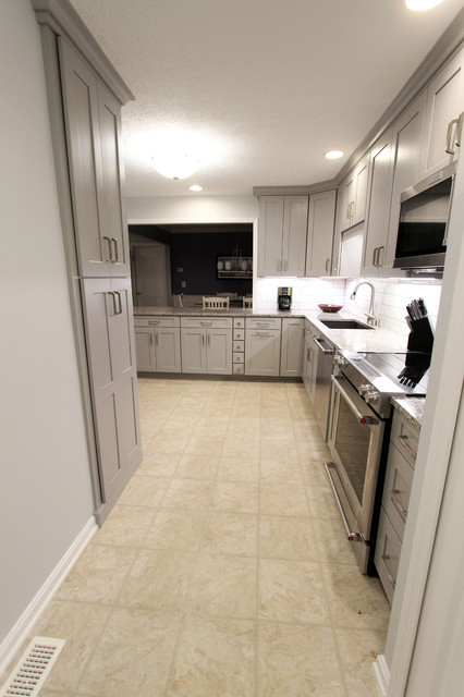 Grey Kitchen With White Subway Tile Backsplash And Granite Countertops Copley Transitional Kitchen Cleveland By Cabinet S Top