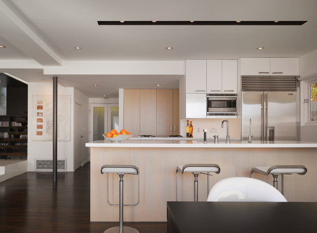 inspiration for a small modern galley dark wood floor eatin kitchen remodel in los