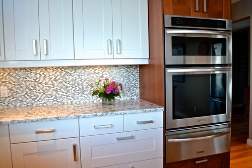 Grimslov (IKEA) shaker cabinets in white and medium brown · More Info