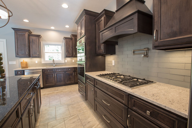 Inspiration for a kitchen remodel in Other with an island