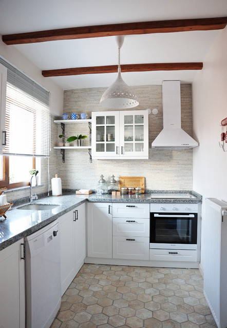 Danish l-shaped kitchen photo in Other with an undermount sink, shaker cabinets, white cabinets, beige backsplash, white appliances and no island