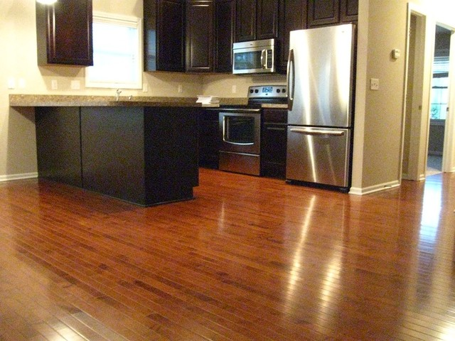 Gunstock maple kitchen floor contemporary kitchen for Hardwood flooring stores