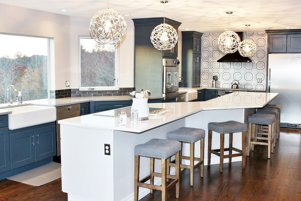 Example of a large transitional u-shaped dark wood floor eat-in kitchen design in Philadelphia with a farmhouse sink, shaker cabinets, blue cabinets, quartz countertops, gray backsplash, porcelain backsplash, stainless steel appliances and an island