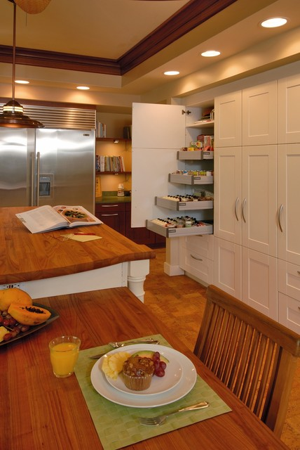 Eat-in kitchen - tropical cork floor eat-in kitchen idea in Hawaii with stainless steel appliances, wood countertops, shaker cabinets and white cabinets