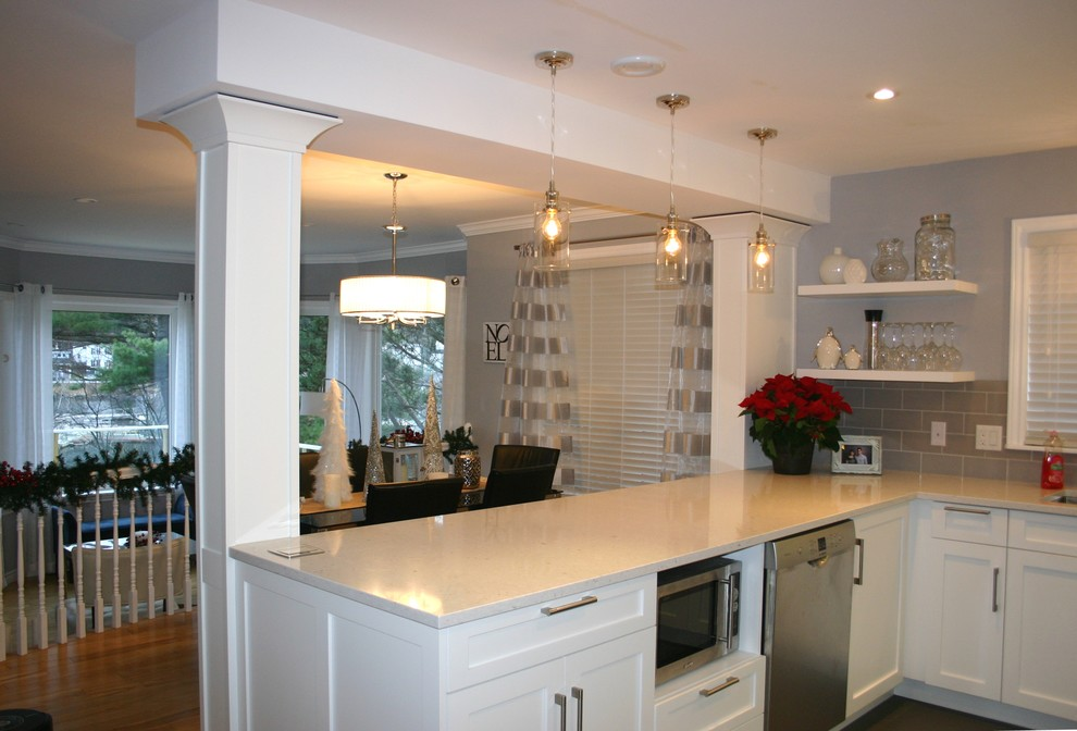 Inspiration for a contemporary u-shaped ceramic floor eat-in kitchen remodel in Other with an undermount sink, shaker cabinets, white cabinets, quartz countertops, gray backsplash, subway tile backsplash and stainless steel appliances