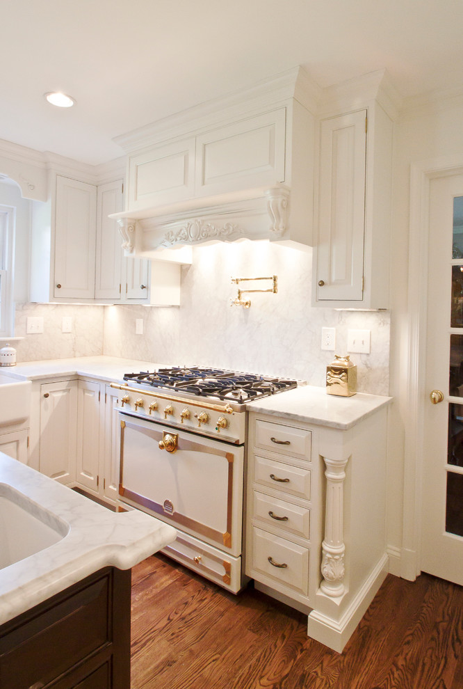 Example of a classic kitchen design in DC Metro with beaded inset cabinets, white cabinets, white appliances, white backsplash and stone slab backsplash
