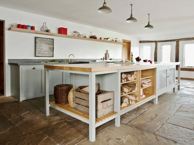 Photo of a country kitchen in London with open cabinets and an island.