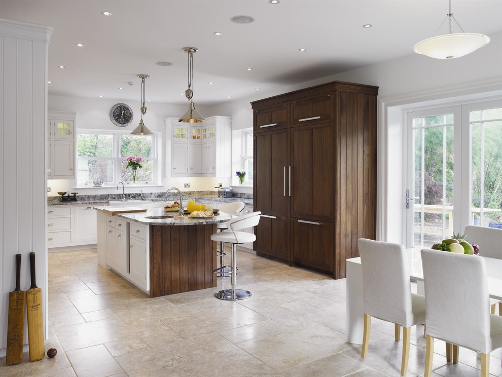 Transitional l-shaped limestone floor eat-in kitchen photo in London with granite countertops and an island