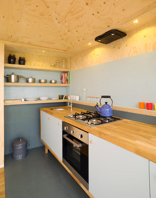 Small mountain style single-wall kitchen photo in Other with an undermount sink, flat-panel cabinets, white cabinets and no island