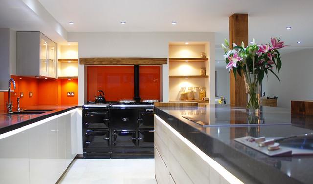 Handleless light grey 100mm quartz worktops and solid oak for Kitchen design uckfield