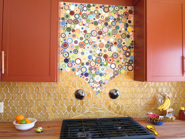 Handmade ceramic tile bubbles and fish, brick red cabinets